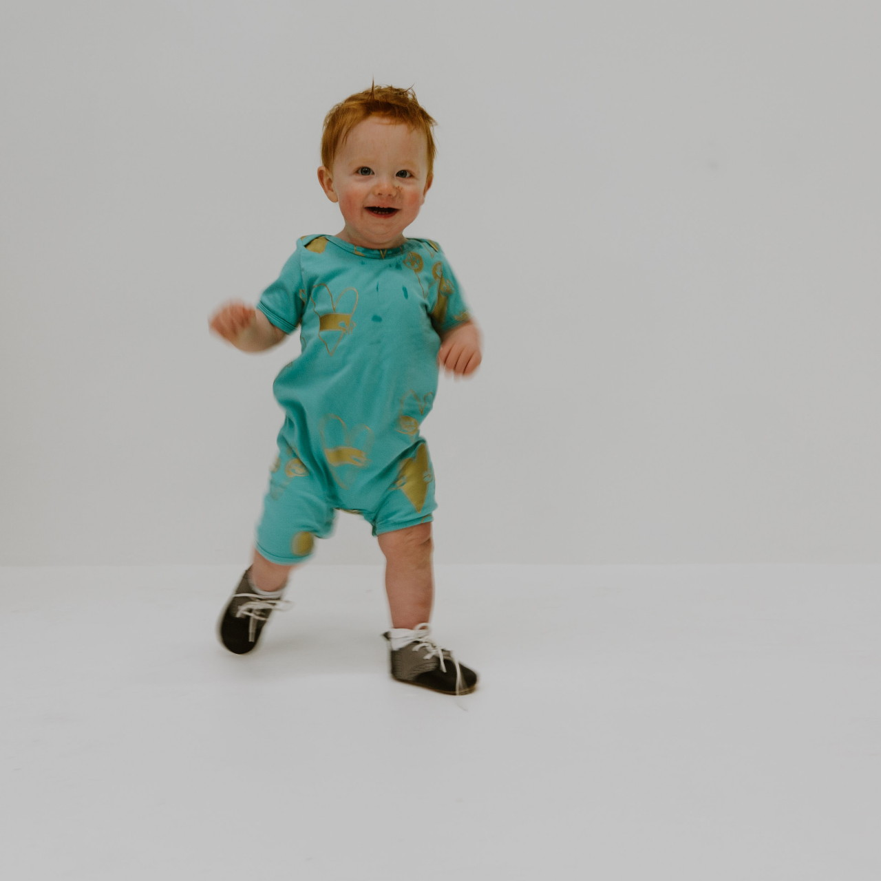 Perfect Aqua romper with metallic gold print by Punk Baby